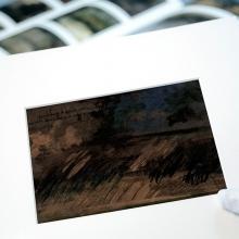 Acabamento e montagem: colocação de  Passe-partout e cartão conservação.